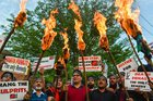 Members of RTI Movement and local residents display placards and hold torches during a protest against the rape and murder of 8-year-old girl of Kathua in Jammu, in Srinagar. PTI