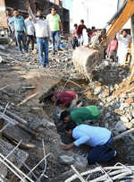 Labourers feared trapped as 4-storey structure gives way