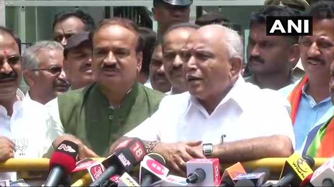 Yeddyurappa stakes claim, Cong tells Guv 'save the Constitution'