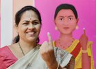 BJP MP Shobha Karandlaje shows her finger stained with indelible ink after cast her vote at a pink polling booth (all woman polling officer) during the polling day for the Karnataka Assembly election in Bengaluru. PTI