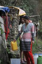 Residents wait to collect drinking water as the city faces water shortage in Shimla on May 31, 2018. AFP photo