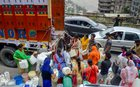 Residents wait to collect water from a truck as the city faces water shortage in Shimla on May 31, 2018. PTI photo