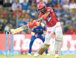 Kings XI go down fighting
