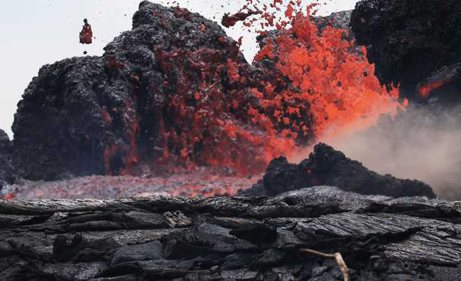 Lava from Hawaii volcano enters ocean from 3 flows  Lava from Hawaii volcano enters ocean from 3 flows 2018 5 largeimg25 Friday 2018 120525292