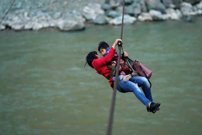 Just zipping out to the shops: Mountain dwellers soar over angry rapids in China  Mountain dwellers soar over angry rapids in China 2018 5 largeimg25 Friday 2018 130104737