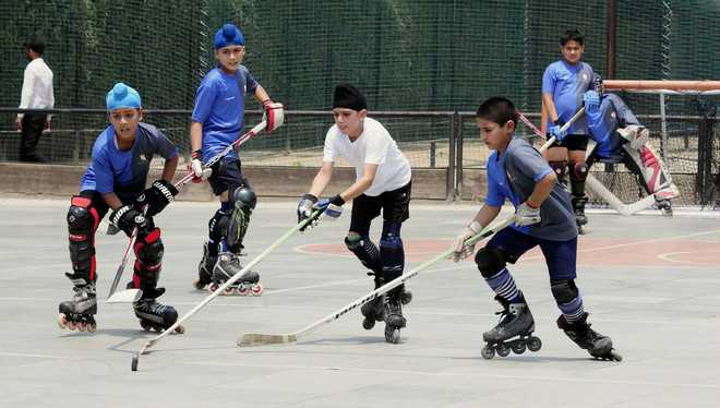 City kids have fun as hockey, skating roll into one