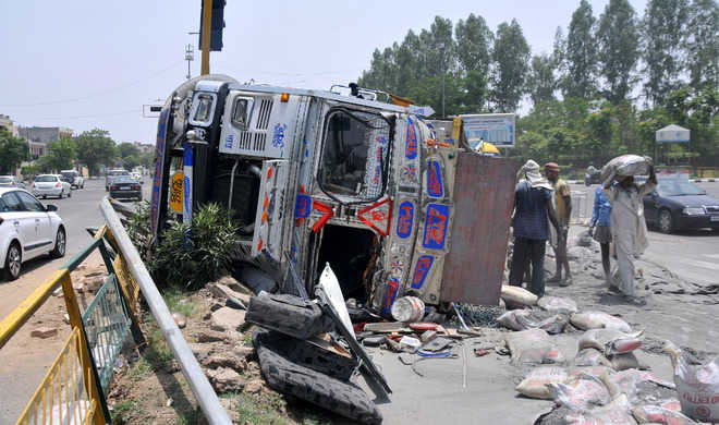 12 hurt as bus, cement-laden truck collide