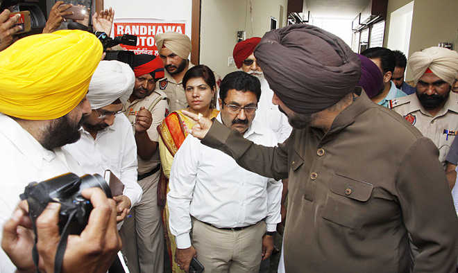 Sidhu talks tough with officials