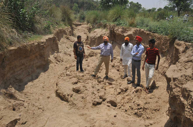 Another village ravaged, miners dig deep