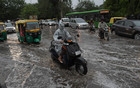 Commuters move on a water-logged road after heavy rain at Sector 17 in Chandigarh on Friday. Tribune photo: Ravi Kumar