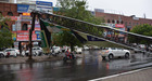An advertisement board of HUDA damaged due to heavy wind at Sector 11 in Panchkula on Friday. Tribune photo