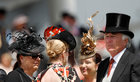 Racegoers attend the second day of the Epsom Derby Festival in Surrey, southern England, on June 2. Via Reuters