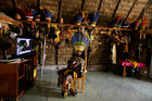 Pareci Indian Chief Roni Pareci watches TV inside his house in the village of Wazare near the town of Campo Novo do Parecis, Brazil, on April 26, 2018. Reuters photo