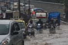 Commuters move through traffic in a flooded street during heavy rain showers in Mumbai on June 9, 2018. AFP photo