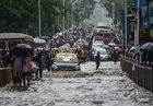 Vehicles and pedestrians move through flooded streets during heavy rain showers in Mumbai on June 9, 2018. PTI photo