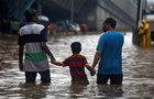 People wade through a waterlogged street after heavy rains in Mumbai on June 9, 2018. Reuters photo