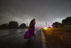 A woman runs for cover as it gets dark during a dust storm before rains and thunderstorm, at Vijay Chowk in New Delhi on June 9, 2018.  PTI photo