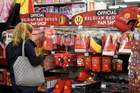This picture taken on June 12, 2018 shows a woman looking at accessories portraying the Belgium national football team the Red Devils on sale at a supermarket chain in Brussels days before the start of the 2018 World Cup football tournament in Russia. AFP photo