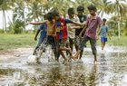 Children play football on the coast of Vembanadu Backwater ahead of the FIFA World Cup, at Vechoor in Kottayam district of Kerala on June 12, 2018. PTI photo