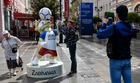 People take a picture in front of a Zabivaka, the official mascot for Russia 2018 football World Cup, on June 13, 2018, in Nizhny Novgorod. AFP photo