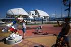 A woman has her picture taken with the official mascot Zabivaka, which means the one who scores in Russian, in front of the Fisht Olympic Stadium in Sochi on June 12, 2018, two days ahead of the Russia 2018 World Cup football tournament.  AFP photo