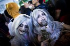 Revellers in costumes pose for pictures during Halloween celebrations in the Shibuya district in Tokyo on October 31, 2015.  Reuters photo
