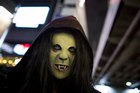 A reveller wearing a mask poses for pictures during Halloween celebrations in the Shibuya district in Tokyo n October 31, 2015. Reuters photo