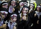 Women dressed as nuns pose for pictures during Halloween celebrations in the Shibuya district in Tokyo on October 31, 2015.  Reuters photo