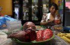 A bloody zombie baby head, brain and a hand made of gummy candy and red jelly are pictured as a woman works (rear) at the Zombie Gourmet homemade candy manufacturer on the outskirts of Mexico City on October 30, 2015. Reuters photo