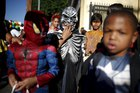Children participate in the School on Wheels Skid Row Halloween Parade for children who live in shelters, motels, cars and on the street, in Los Angeles on October 30, 2015. Reuters photo