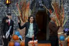 US President Barack Obama and first lady Michelle Obama wave as they arrive at a Halloween trick-or-treating celebration on the South Lawn of the White House in Washington on October 30, 2015. Reuters photo