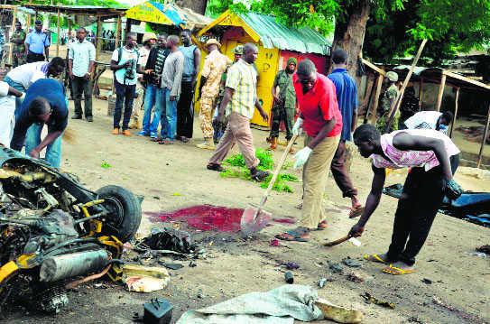 Nigeria attacks kill 16, force chief vows Boko Haram crush