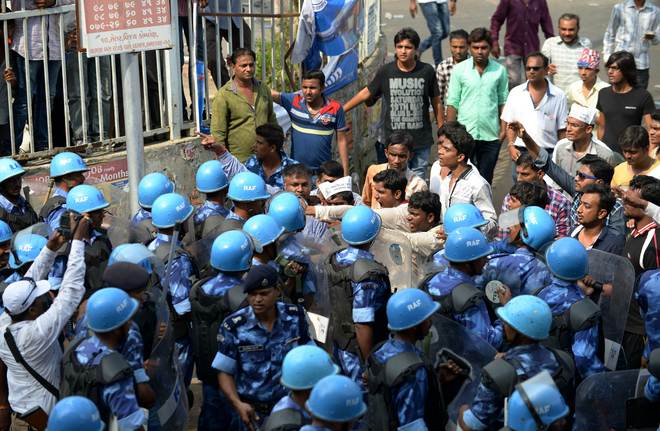 Gujarat tense as Patels' rally for reservation turns violent