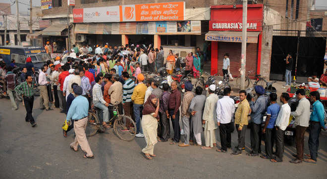 Day 2: Banks open to long queues