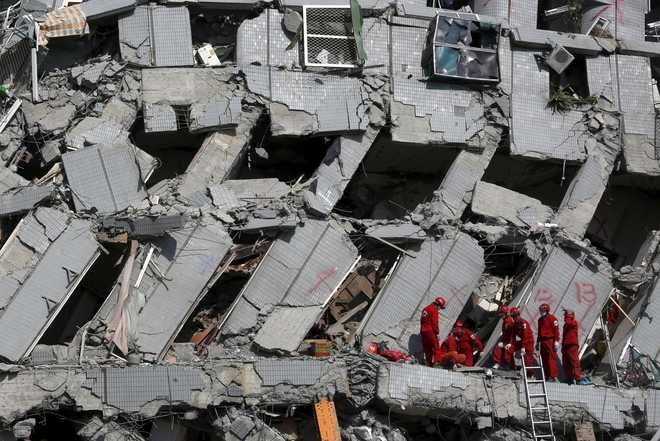Rescuers find signs of life in quake rubble in Taiwan