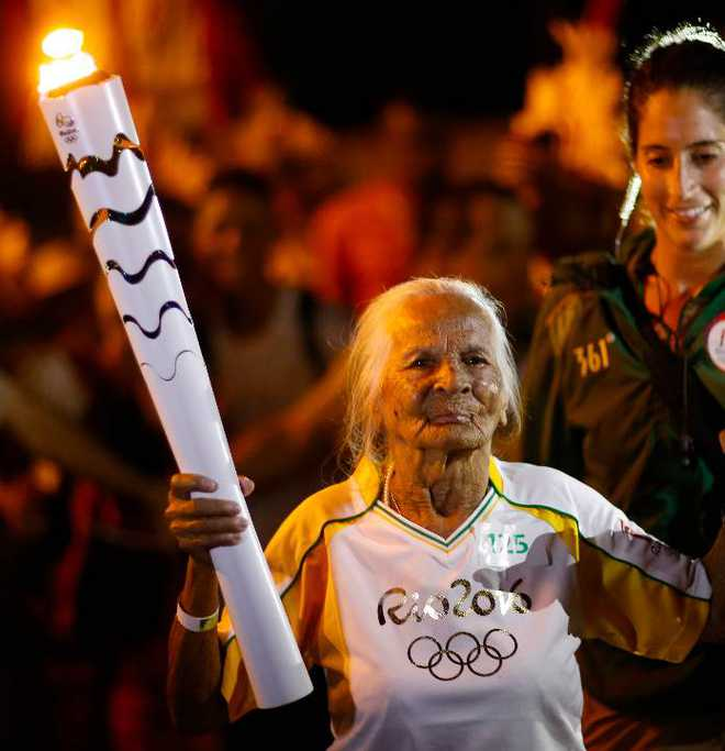 106-year-old woman becomes oldest Olympic torch bearer