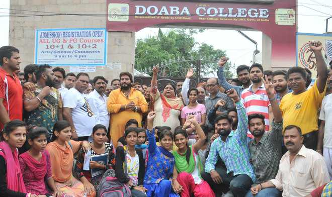 Sanitary staff line up garbage trucks outside college