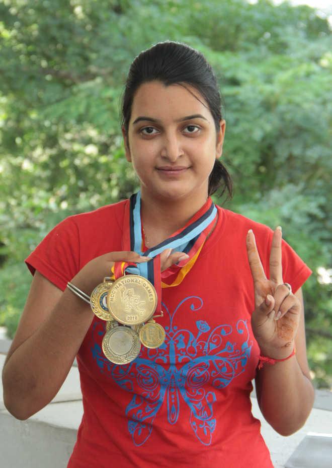 Despite facing financial crisis, daughter of a tailor wins national shooting event