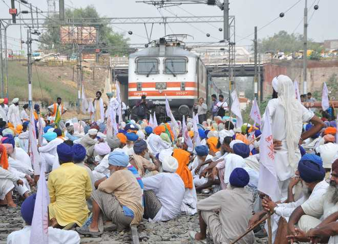 The Tribune India : Trains diverted as farmers block rly tracks