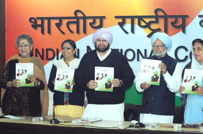 Manmohan releases Cong Punjab manifesto: Cheap power, police reform promised