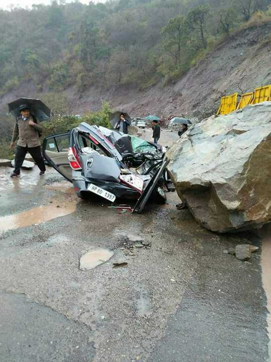 4 of family survive miraculously after boulder falls on car
