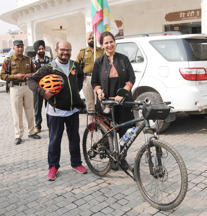 With gender equality in mind, he pedals across country