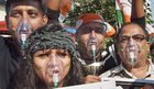 Congress activists wear oxygen masks during a protest rally on the 1st anniversary of demonetisation move, in Kolkata on Wednesday. PTI
