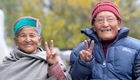 An old couple with smiling faces come out after casting their votes at one of the polling stations at Kalpa, a small town in the Sutlej river valley, above Recong Peo in the Kinnaur district of Himachal Pradesh. Tribune Photo: S Chandan