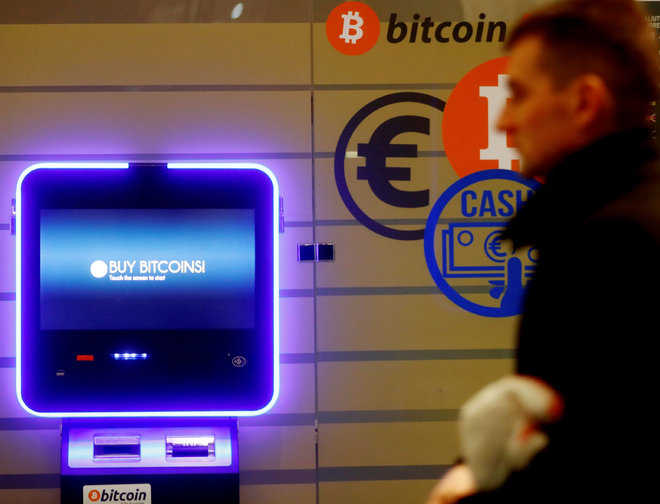 Bitcoin surges past $15,000 for first time, concerns mount