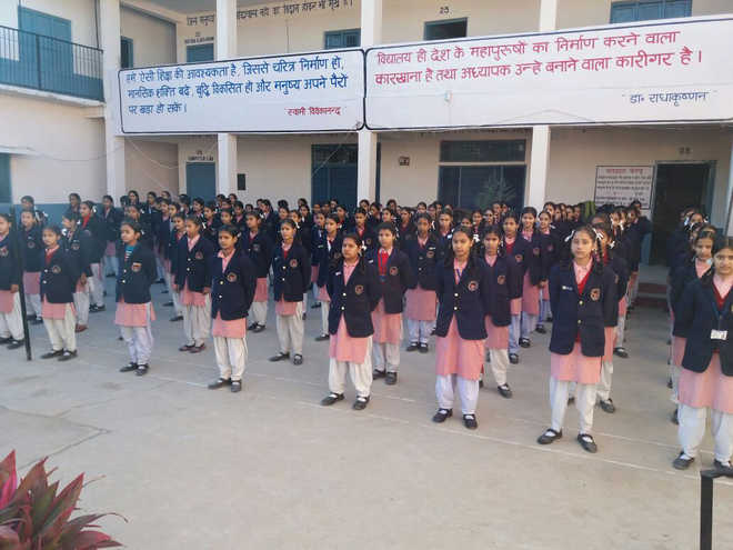Principal chips in with PF money to buy blazers for students