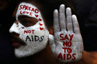 A student displays his face and hand painted with messages during an HIV/AIDS awareness campaign on the occasion of World AIDS Day in Chandigarh, December 1. Reuters