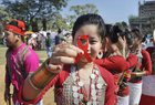 A girl displays a red ribbon, which is used as the symbol for solidarity with people living with HIV/Aids, during an awareness campaign on World Aids Day in Agartala on Friday. PTI