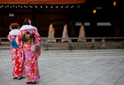 Shinto priests walk in a line to attend a ritual to usher in the upcoming New Year as women in kimonos look on at the Meiji Shrine in Tokyo, Japan, December 31. Reuters