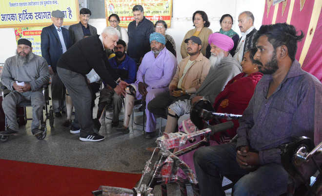 Artificial limbs, calipers & hearing aids distributed